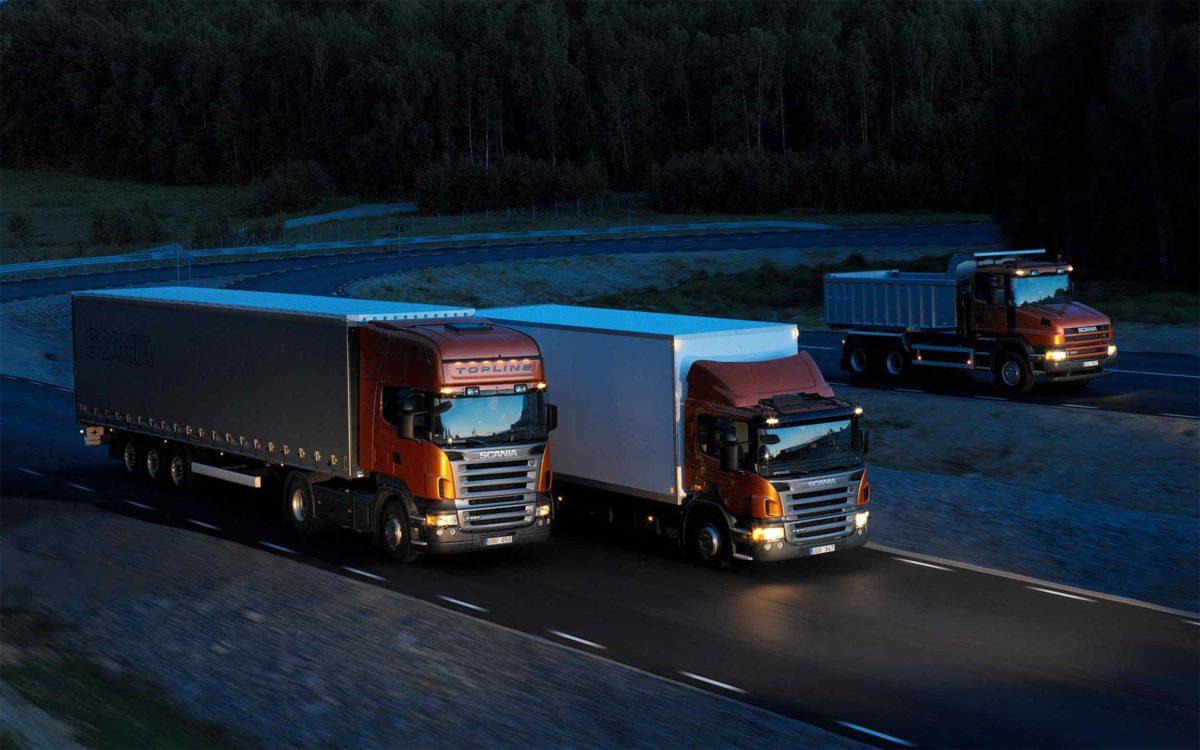 Three-orange-Scania-trucks-1200x750.jpg
